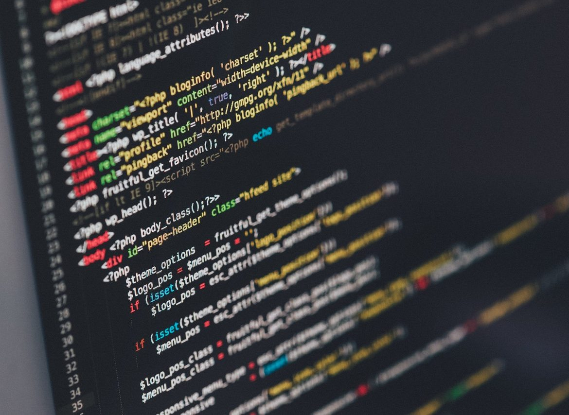 A computer screen apparently casts in coding a WordPress theme.